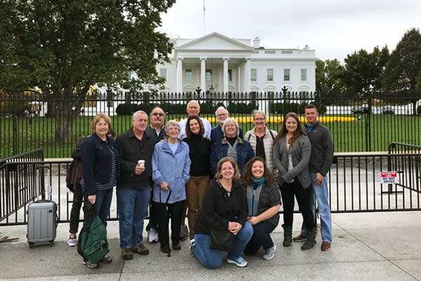 family on special occasion tour posing at the White House